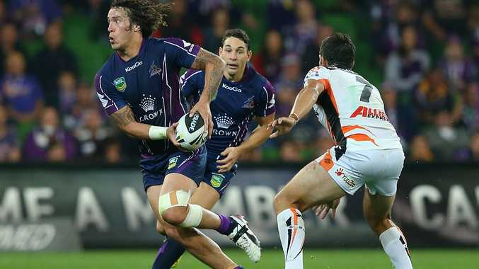 Kevin Proctor of the Storm passes the ball during the round 5 NRL match between the Melbourne Storm and the Wests Tigers at AAMI Stadium on April 8, 2013 in Adelaide, Australia.