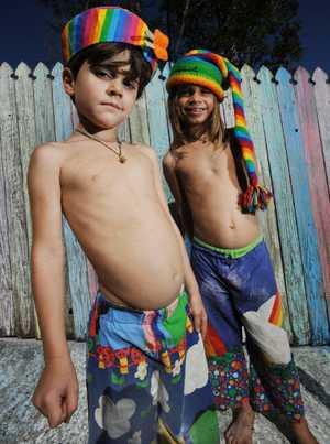 BRIGHT BROTHERS: Kinta, 5, and Takoda, 7 of East Ballina and their technicolour rainbow fence.