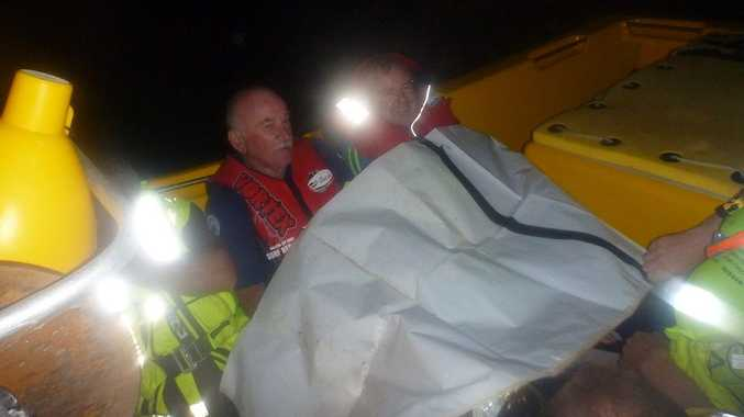 Two of the boat crew members rescued by the Ballina Jet Boat from Ballina's capsized Marine Rescue vessel on Monday, April 15, 2013.