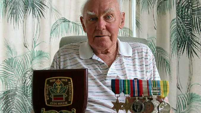 Rex Baguley with his Battalion plaque and medals from his four years with the Australian Army.