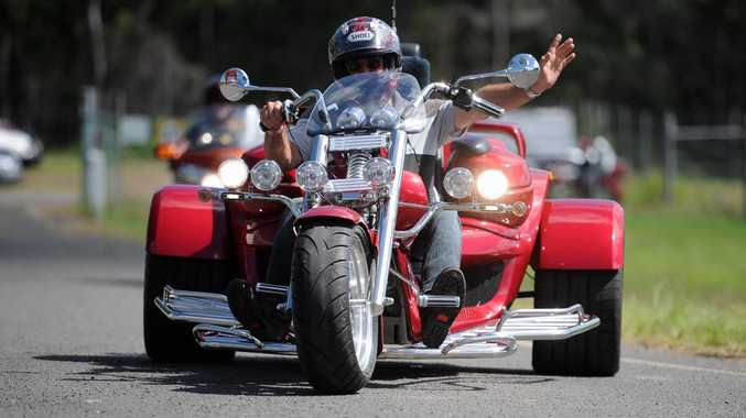 A biker arrives back at the Maryborough showgrounds after a ride during the Ulysses AGM.