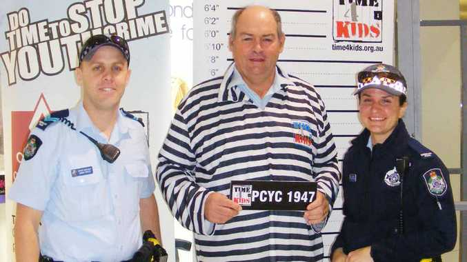 BAD COP: Senior Constable Aaron Corles and Constable Renee Hogan guard the prisoner Sgt Bruce Pratt.