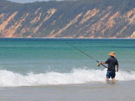 Fisherman fishing Rainbow Beach.