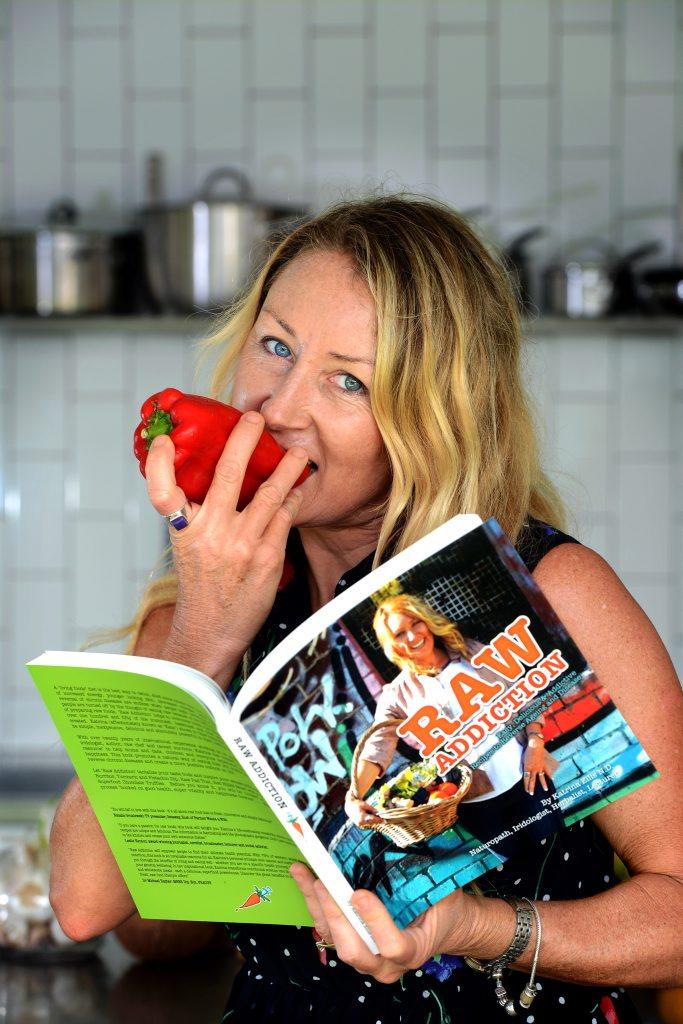 Katrina Ellis in the kitchen with her Raw vegan food.