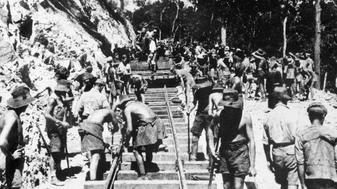 Australian and British prisoners of war (POWs) laying track on the Burma-Thailand railway. Photo Department of Veteran Affairs