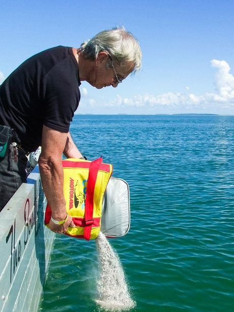 Ulysses member Bernie Dorksen releasing the ashes of his parents Bob and Marga Croom between Big and Little Woody islands.
