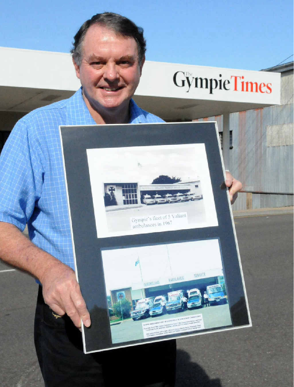 Wayne Sachs with old ambulance building pictorial history that he donated to The Gympie Times this week.