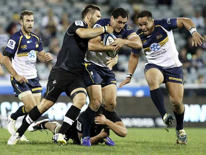 George Smith of the Brumbies is tackled during the round eight Super Rugby match between the Brumbies and the Kings at Canberra Stadium on April 5, 2013 in Canberra, Australia.