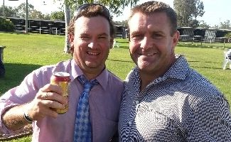 Family will celebrate the life of Jason Lewis tomorrow, who was tragically killed in a single vehicle crash last Friday. ABOVE: Jason enjoying a beer with football great Shane Webcke at Roma Picnic Races.