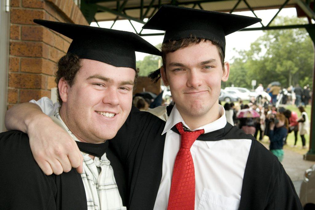 Bachelor of Creative Arts recipients Karl Pumpa (left) and Nicholas Barltrop at a 2012 USQ graduation.