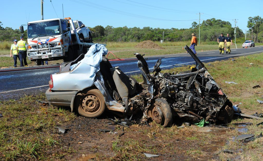 ROAD CARNAGE: The scene of the fatal accident ten kilometres south of the Coonarr turnoff on Goodwood Road. Photo: Mike Knott / NewsMail