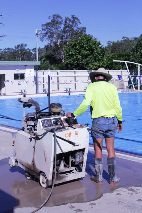 Crews have started cutting the concrete around the 25m outdoor heated pool at the Hervey Bay Aquatic Centre to build a new roof.