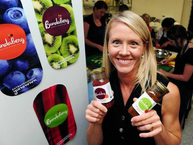 Impact CEO Tanya O'Shea shows off the produce.