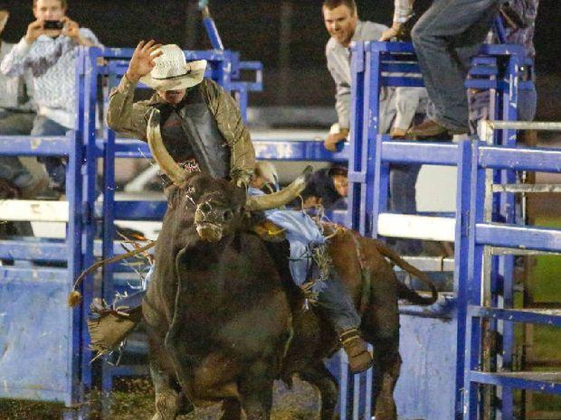 HANG ON TIGHT: Grafton bullrider Sonny Gray, 20, tries to ride Hotshot at the Grafton Show. Photo Adam Hourigan