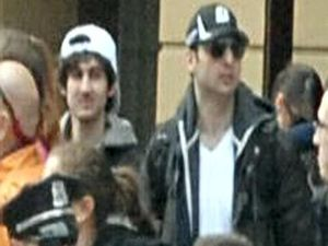 Boston bombing suspect shot dead, another on run