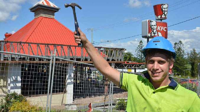 Apprentice Tate Graham on site, renovating the KFC store on the Bruce Hwy.