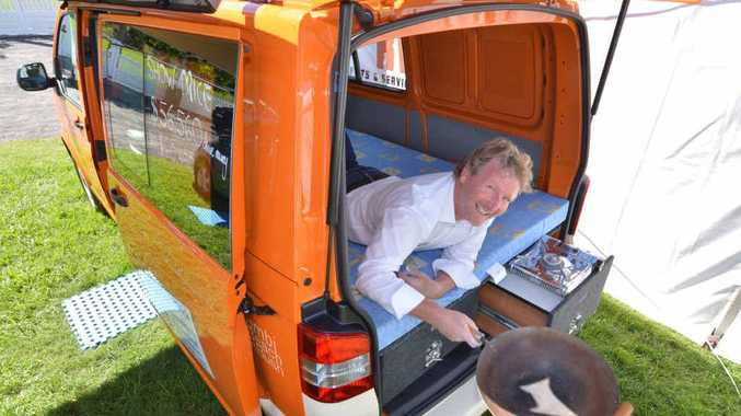 Lance Hunt has a taste of the latest VW Kombi camper at the caravan show in Nambour.