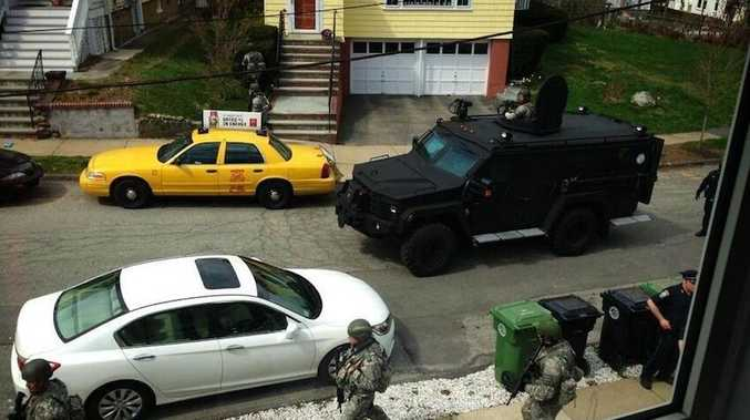 Boston is in lockdown as police and military hunt one of the bombing suspects.  Source: Twitter