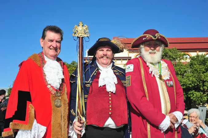 Mayor Mick Kruger with town criers Mark Overell and John Deeks in Queens Park on Saturday. Photo: Nat Bromhead / Fraser Coast Chronicle