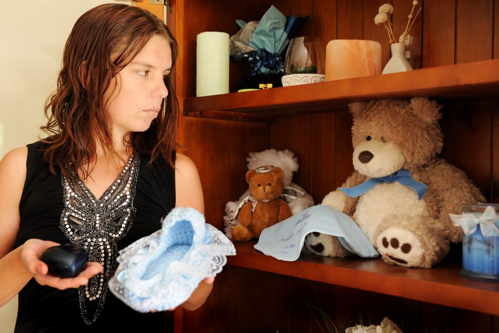 Jodie Tangikara holds precious the ashes of her fifth child, Marcus, and the knitted bed that he would have fitted in.