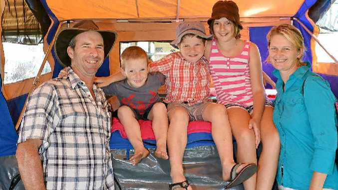 Peter and Liz Ronan with Mitchell, Isaac and Ebony check out a camper trailer at the expo yesterday.