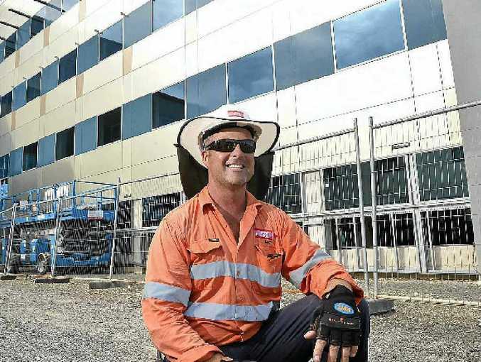 Site supervisor Matt Fernandez outside the new private hospital.