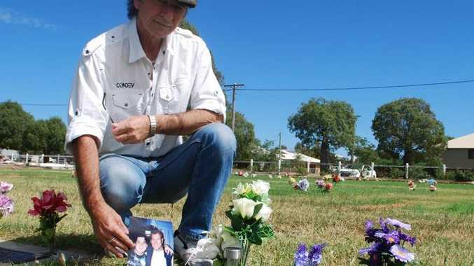 Alan Espie with a picture of his son Chris with Jimmy Barnes at Chris's grave in Roma Lawn Cemetery.