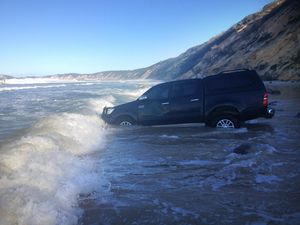 Two utes swallowed in the drink at Mudlo Rocks