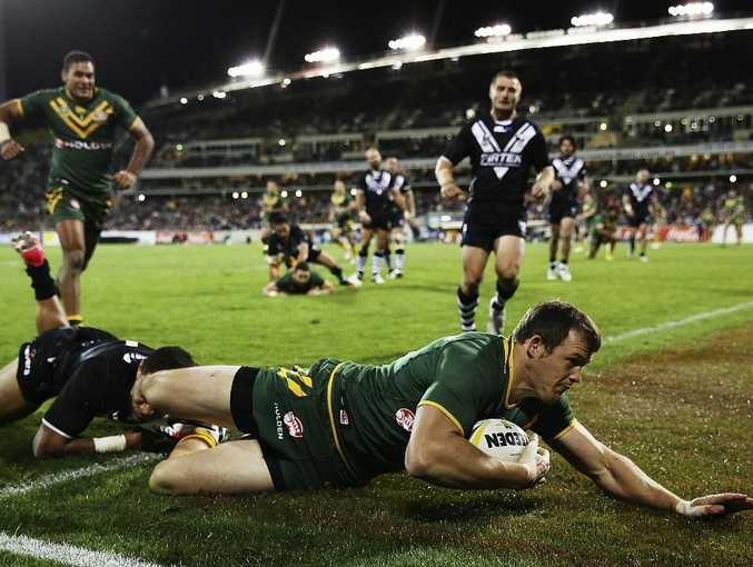 Brett Morris of the Kangaroos scores a try during the ANZAC Test match between the Australian Kangaroos and the New Zealand Kiwis at Canberra Stadium on April 19, 2013 in Canberra, Australia.