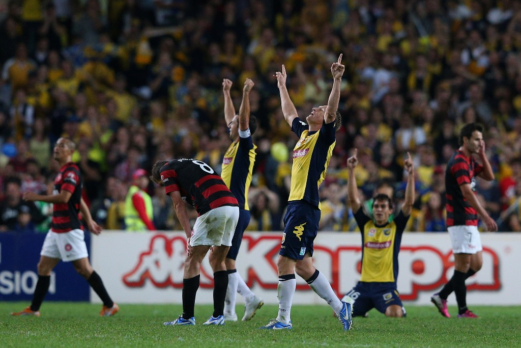 Daniel McBreen of the Mariners and team mates celebrate winning the A-League 2013 Grand Final match between the Western Sydney Wanderers and the Central Coast Mariners at Allianz Stadium on April 21, 2013 in Sydney, Australia.