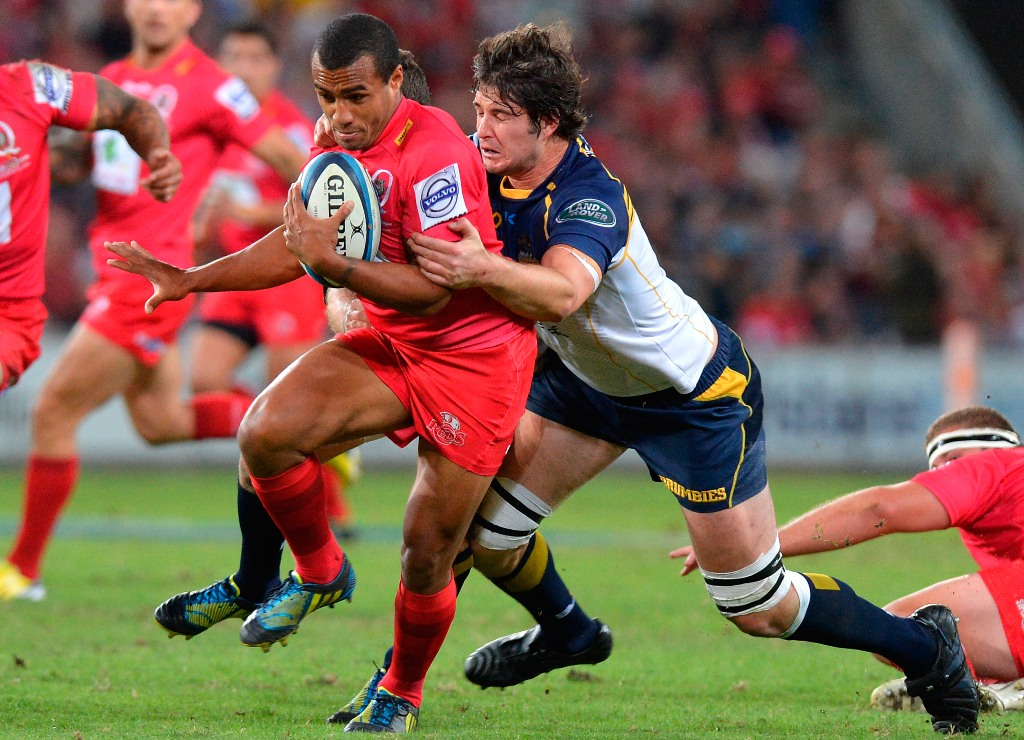 Will Genia of the Reds attempts to break free from the defence during the round 10 Super Rugby match between the Reds and the Brumbies at Suncorp Stadium on April 20, 2013 in Brisbane, Australia.
