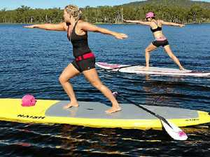New trend combines paddle boarding with pilates
