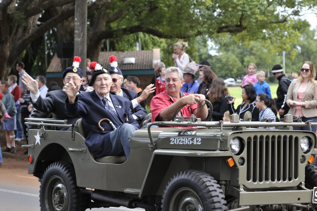 Returned veterans ride military Jeeps to the Mothers&squot; Memorial for last year&squot;s Anzac Day service.