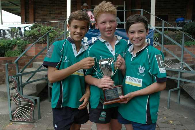 Hugo Burdon, Evan McLean and Will Stevens with the trophy their team was presented as the TAS Rugby Carnival KooGa Team of the Carnival. Photo Contributed