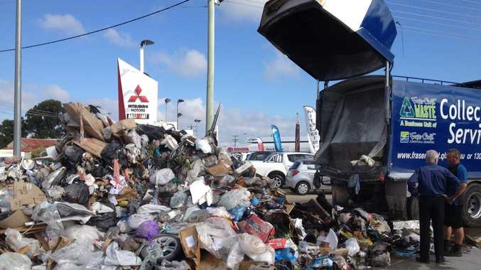 A driver dumped rubbish onto a Hervey Bay car dealership yard when the load started smoking after the truck's forks hit powerlines.