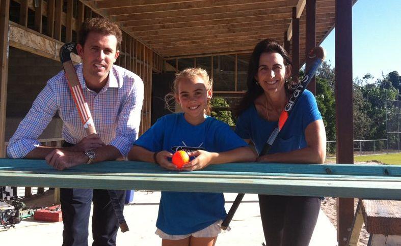 Villawood development manager Michael Williams with Jade Reid and Sharon Buchanan at the Casuarina Hockey Club.