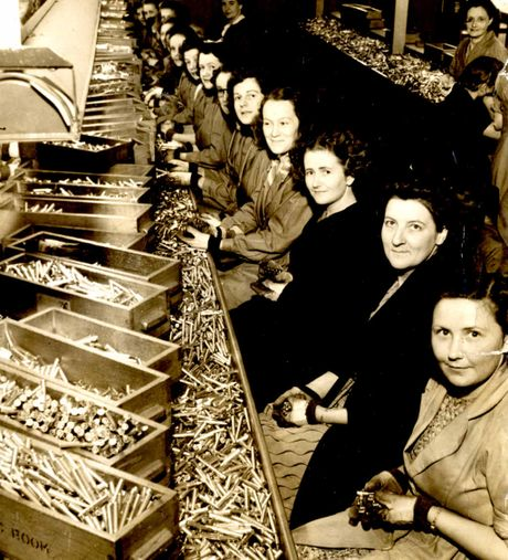 Rita Smith (front) on the assembly line and (inset) the set of salad servers.