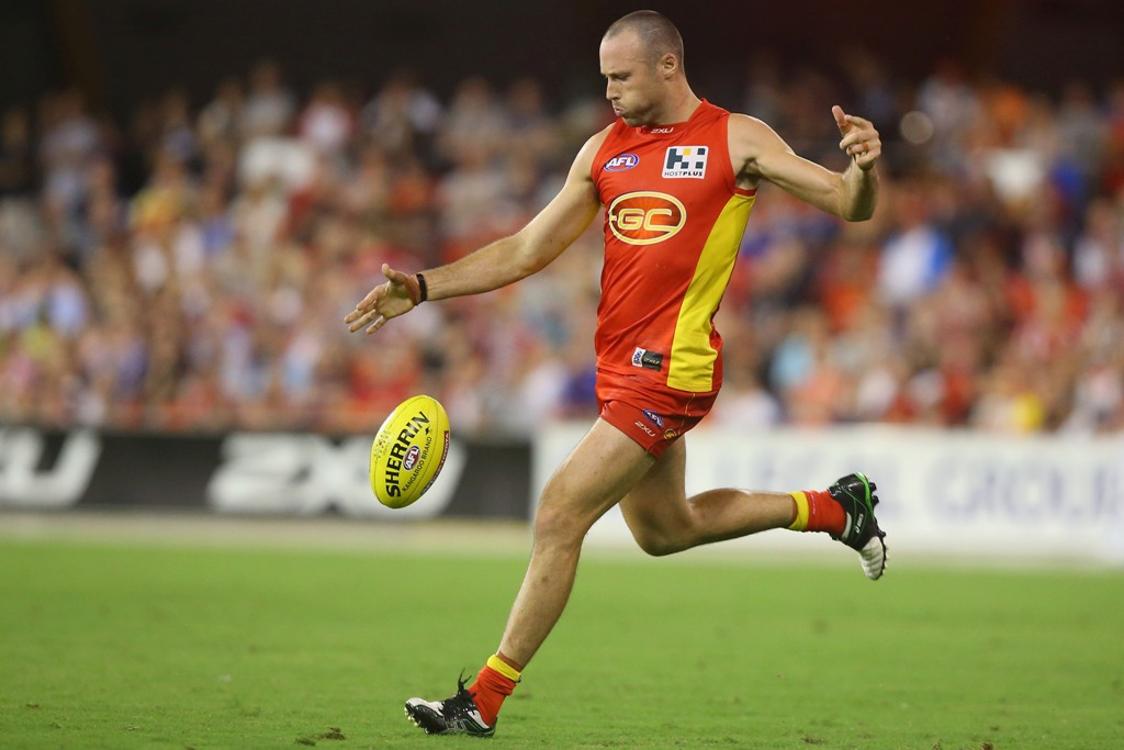 Matthew Warnock of the Suns kicks during the round one AFL match between the Gold Coast Suns and the St Kilda Saints at Metricon Stadium on March 30, 2013 in Gold Coast, Australia.