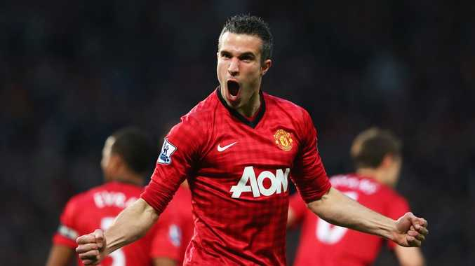 Robin van Persie of Manchester United celebrates scoring the opening goal during the Barclays Premier League match between Manchester United and Aston Villa at Old Trafford on April 22, 2013 in Manchester, England.