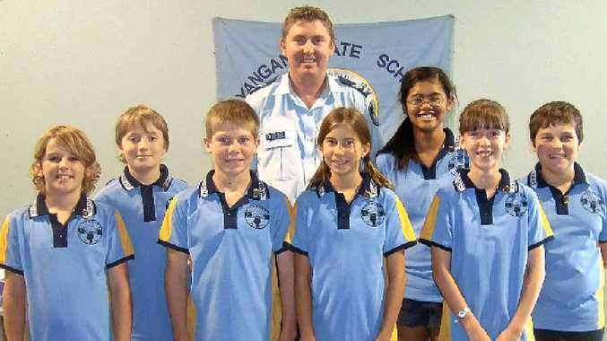 From left: Jake Hartwig, Max Grayson, Aiden Steele, Senior Constable Nathan Burnett, Anu Woodruff Becker, Prisca Albendia, Isabella Hawes and Lindsay Payne.