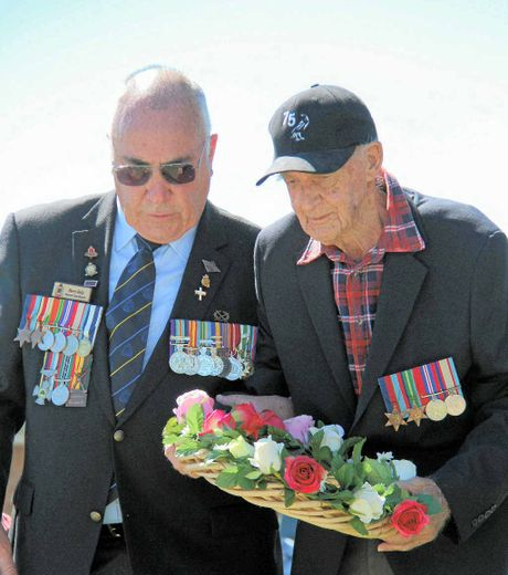 Warwick RSL sub-branch chaplain Barry Kelly helped veteran Edgar McCulloch lay a wreath at the flag pole during the Akooramak Anzac Day.