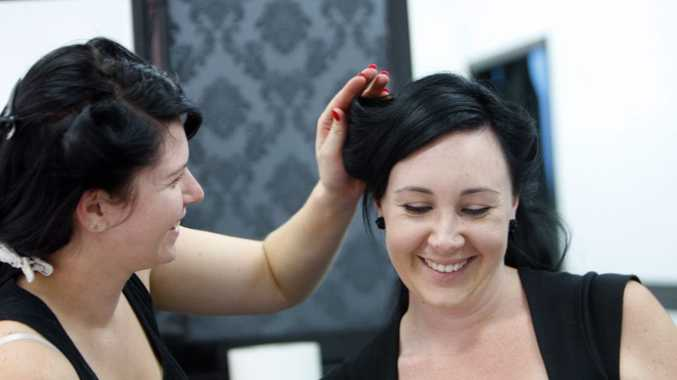 Ipswich women learn about vintage hair and make up styles from The Bombshell Burlesque and Beauty Academy. Photo: Claudia Baxter / The Queensland Times