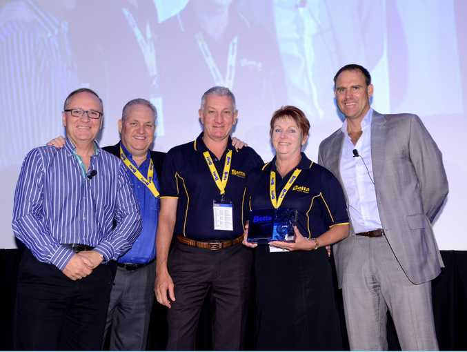 North Rockhampton Betta Home Living owners Gary and Carmel Thomasson (centre) with (from left) Betta Home Living CEO Graeme Cunningham, chairman of the board Garry Thyer and Betta's Captain of Cooking cricketer Matthew Hayden.