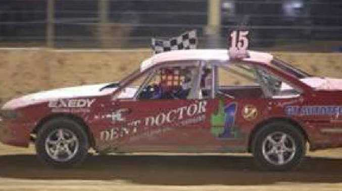 Gympie's Tim Atkin racing to victory at the weekend's Victorian production sedan titles.