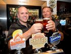 Nick Wiseman and Don Birt, father of the late Corporal Ashley Birt, share a beer in his honour at the Royal Hotel yesterday. A special beer brewed in his honour called Birty's Bitter, made its commercial debut yesterday.