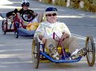 Douglas Young (front) and Jason Duley compete in 2005. Below is Douglas Young's billycart derby trophy.