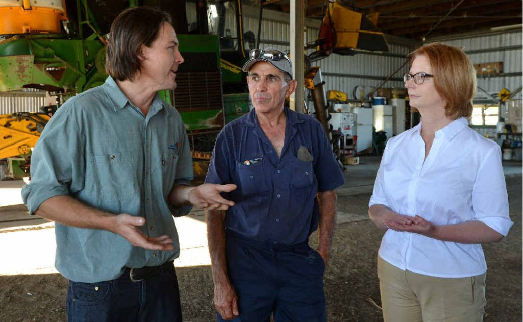 Mackay-Whitsunday Reef Catchments' Will Higham (left), cane farmer Tony Bugeja and Prime Minister Julia Gillard discuss the Reef Rescue program Tony's Walkerston-Homebush Rd farm yesterday.
