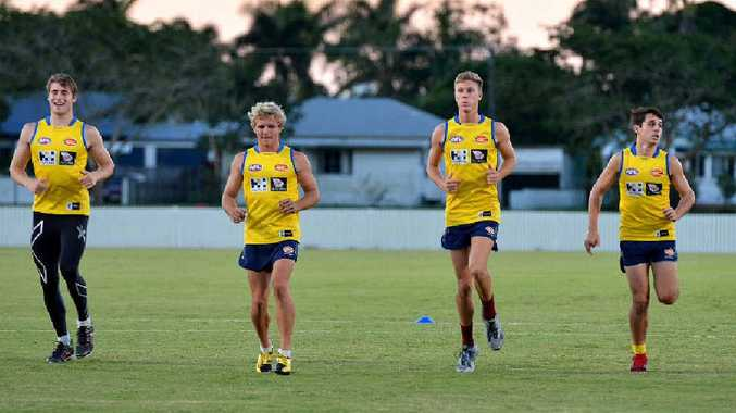 Gold Coast Suns Reserve team player Clay Cameron with locals Aaron Wade, Darcy Trask and Todd Carboneduring a training session before their Anzac Day clash with the Brisbane Lions.