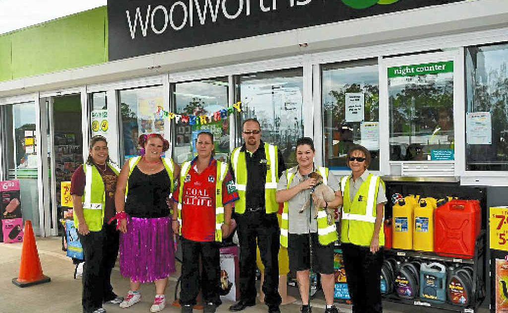 HAPPY DAY: Amanda Foster, Nadisha Johnston, Manager Renee Wallace, Area Manager Matt Griffith, Renee Meh Jessen and Sandy Davie celebrated Kirkwood Woolworths petrol station's first birthday last Saturday.