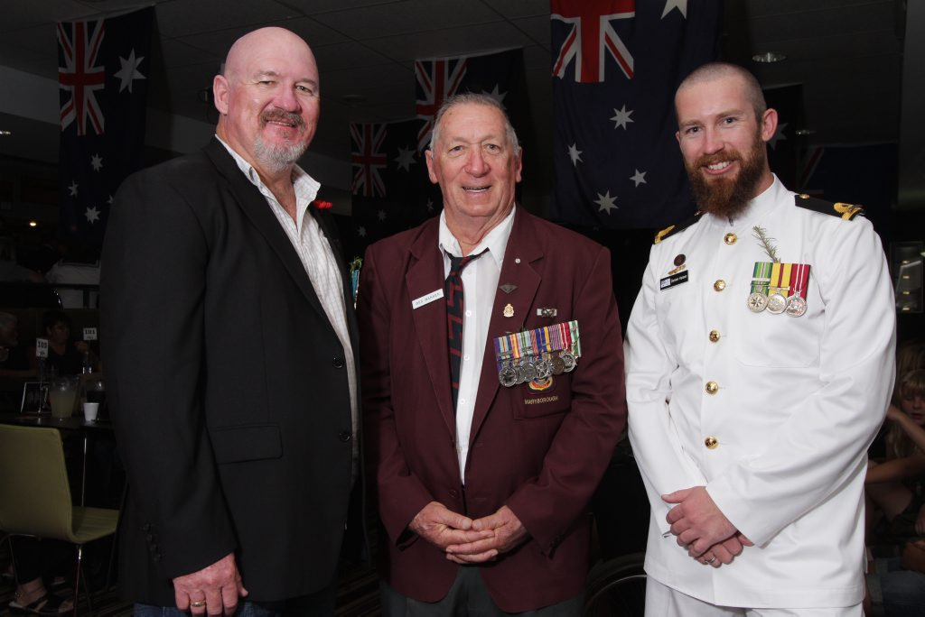 Three generations, Alan Hansen, Des Hansen and Damien Hansen, relax at the Maryborough RSL after marching in the Anzac Day parade.